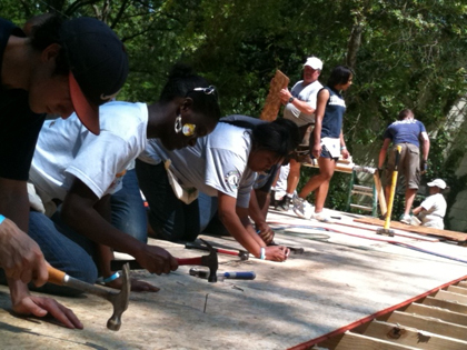 Jackson State University ARM members assist with building a Habitat for Humanity house for a family